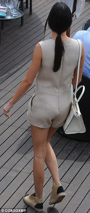 Lucky girl: She was also carrying a large white designer handbag on her shoulder