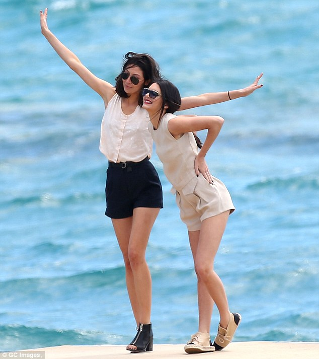 Star power: Her brunette companion threw out her arms while Kendall came in closer as a friend took the snap