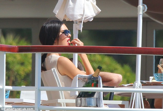 Bliss: Kendall looked on cloud nine as she reclined in her chair at the luxury hotel