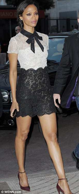 Tres chic: Later in the day, Zoe seemed to have gone for a French-inspired look with a lace dress sporting a white bodice, a black hem and a contrasting pussy-bow
