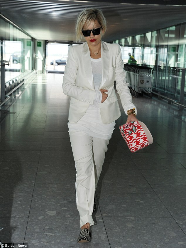White heat: Rita wore print flat shoes for her trip to France