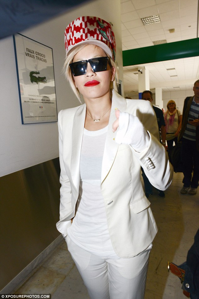 Punching above her weight: Rita wore a white top with very long sleeves that made her hands look like a boxer's
