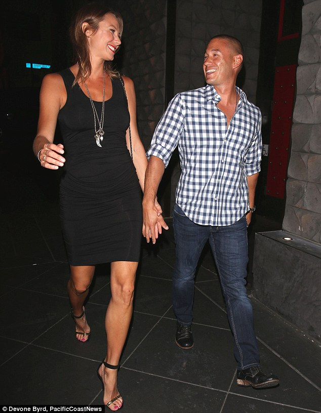 The long and the short of it: Stacy Keibler towered over her husband Jared Pobre as they headed out for dinner on Thursday night in West Hollywood