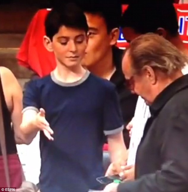 Split-second chance: In a funny Vine video taken by a fan, a boy around 12 years old held out his hand to the oblivious 77-year-old movie star