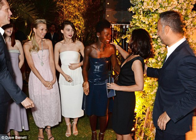 Playful: Julianne, Naomi, Rooney,  and Lupita joked around with Francisco Costa, Women's Creative Director of Calvin Klein Collection
