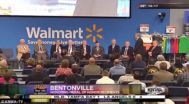 Living history: Earlier in the day on Thursday, Wal-Mart sponsored a separate gathering of Medal of Honor recipients at its Bentonville, Arkansas headquarters; Bush did not attend that event