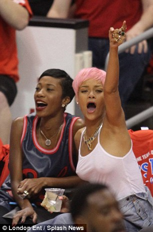 A show of support: Rihanna and Melissa cheer their team on, but to no avail