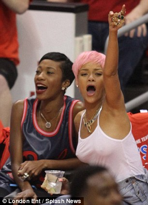 Celebrating: Rihanna enjoys the game
