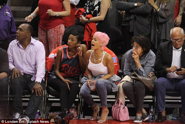 Excited: Rihanna cheered the teams on from the sidelines as the Thunder sealed victory in LA