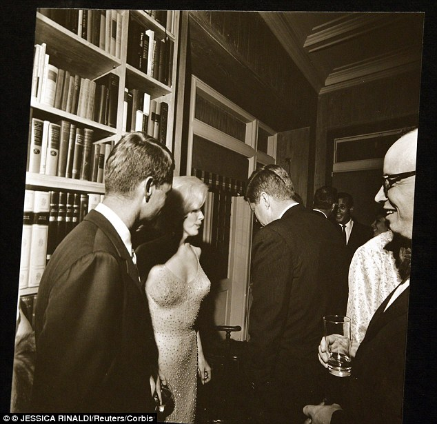 Torn between two lovers: Marilyn had affairs with both Kennedy brothers, the authors claim. She was obsessed with Jack and Bobby and wrote about their trysts and other Kennedy secrets in a little red book