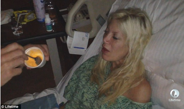 The devastated 47-year-old tell the camera: 'Tori's afraid of being in the hospital and I can't be there with her'