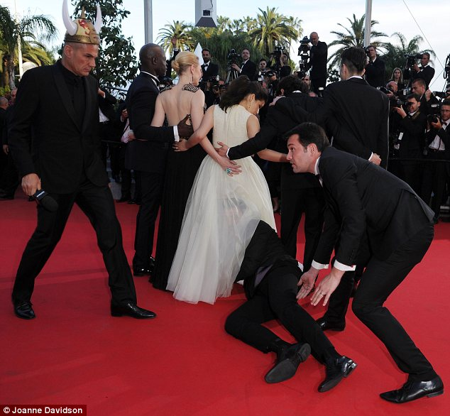Unwanted guest: Pest Vitalii Sediuk has struck again, crashing the How To Train Your Dragon 2 red carpet Cannes premiere to climb under America Ferrera's dress