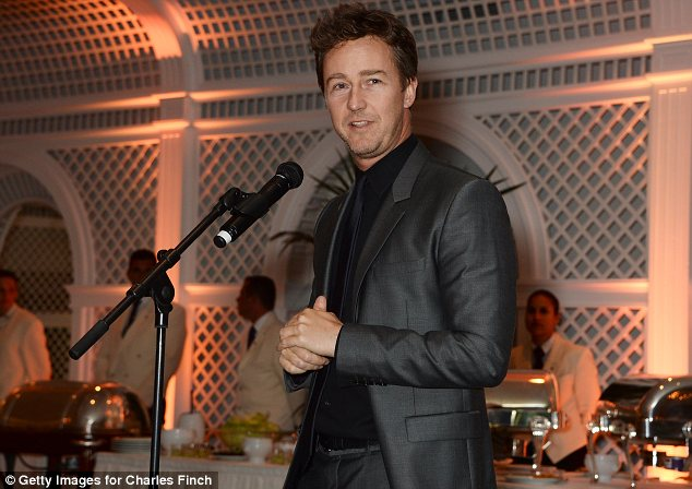 Working the crowd: Norton took to the stage at the dinner, looking elegant in a grey suit