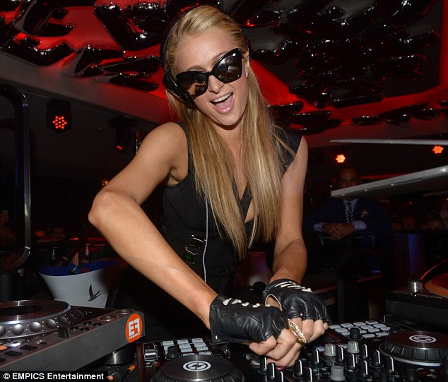 Party time: The Hilton heiress slipped on sunglasses to perform her DJ set at the night club