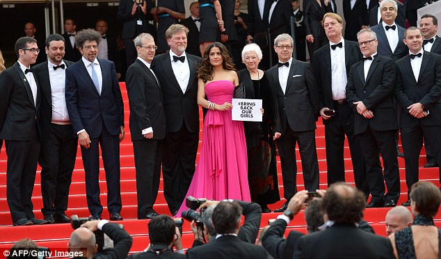 All for one and one for all: The star was joined by directors (L-R) Tomm Moore, Joan Sfar, Paul Brizzi, Roger Allers, Joan C. Gratz, Gaetan Brizzi, Bill Plympton and the General Delegate of the Cannes Film Festival Thierry Fremaux (right)