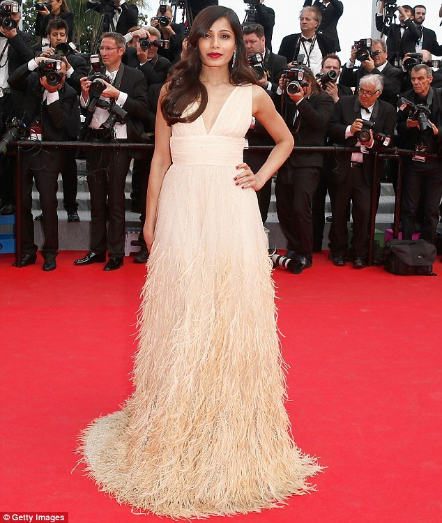 Fabulous in fringe: Freida Pinto dazzled in a feathered champagne gown
