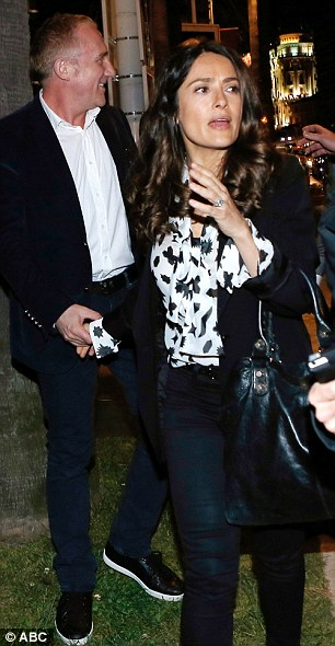 Romantic night out: Salma clutches her husband Francois-Henri Pinault's hand as they leave a restaurant in Cannes