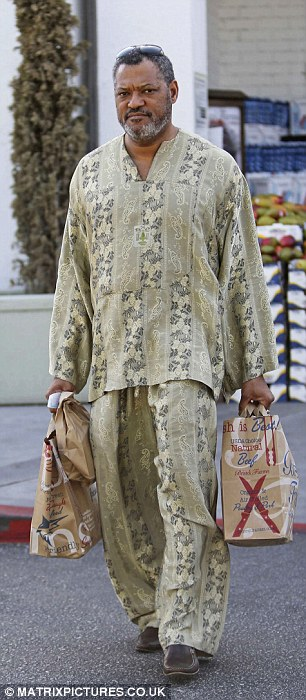 Easy breezy: The 52-year-old actor kept cool in an African-inspired loose tunic and pant suit that featured a bold pattern throughout
