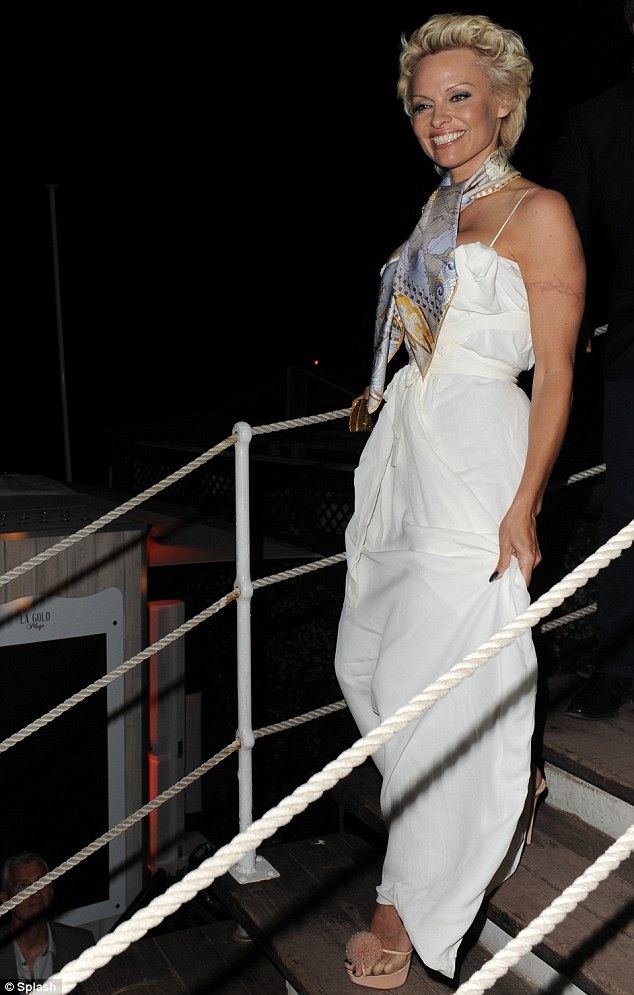 Ship-shape: The star carefully made her way down the steps in her towering pale pink satin peep-toe platform stilettos, which featured a pretty floral toe detail