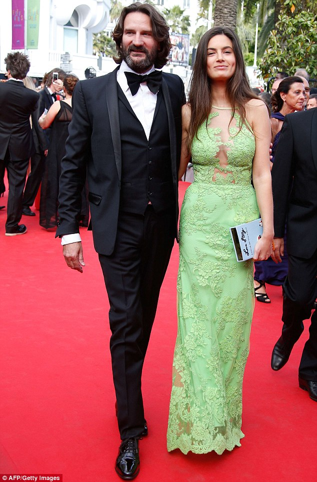 Pretty in pastel: French writer Frederic Beigbeder, left, came with his partner Lara, who was wearing a lacy light green gown