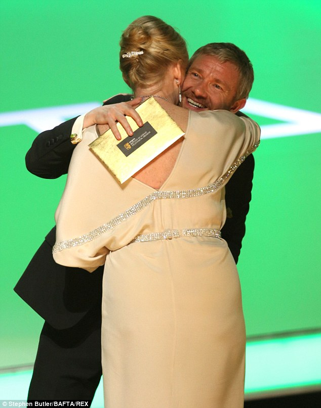 Happy hug: Martin Freeman presented Sarah the award on Sunday night