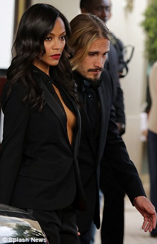 Suiting up: The 35-year-old actress and her artist beau, 34, both wore black tuxedos