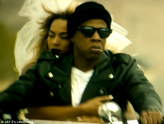 Riders of the storm: So deep is their relationship that in the middle of all the violence, the pair find time to get married and a veil-clad Beyonce rides off into the sunset on the back of Jay Z's Harley Davidson