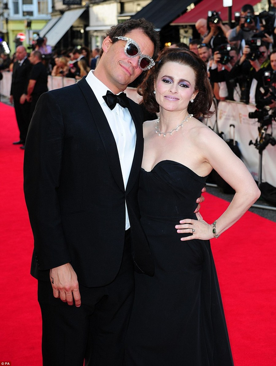 Burton and Taylor: Dominic West tries on his co-stars glasses for size while she reveals her purple make-up style