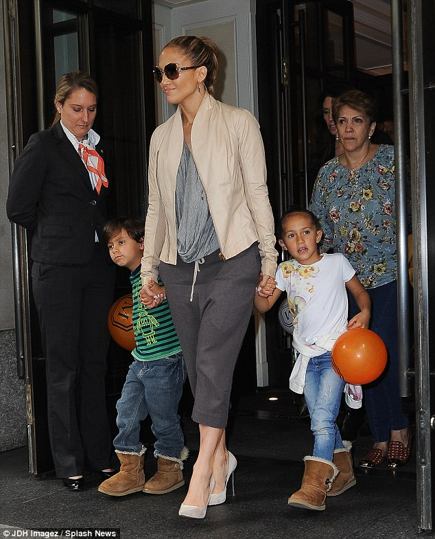 Doting mom: Jennifer admitted that he own mother (pictured back right) helps look after her kids Max and Emme last week in NYC