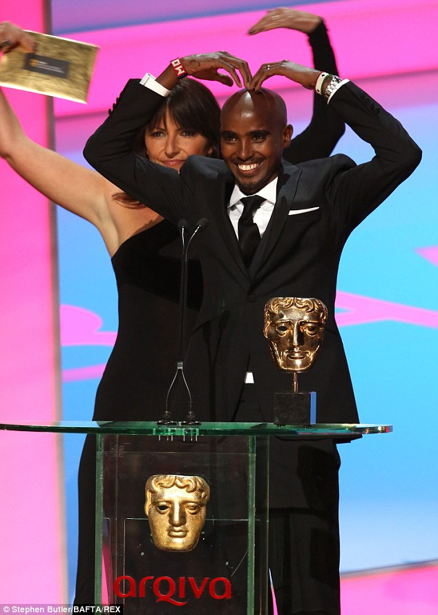 Popular: Olympian Mo Farah performs his victory salute with Davina McCall
