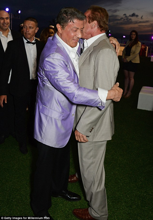Hug it out: Stallone appeared to have pulled Schwarzenegger in for an embrace