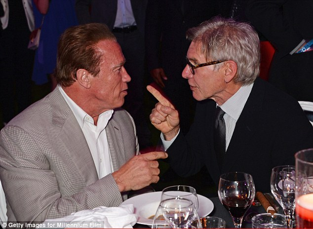 Take my advice: The actor appeared to be taking some sage wisdom from actor Harrison Ford at the party