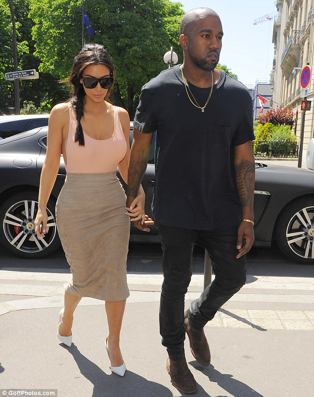 Tres chic! Opting for comfort for his day out in the French capital, Kanye slipped on a pair of chocolate brown suede loafers, and accessorised with numerous gold chains as he strolled hand-in-hand with his stunning wife-to-be