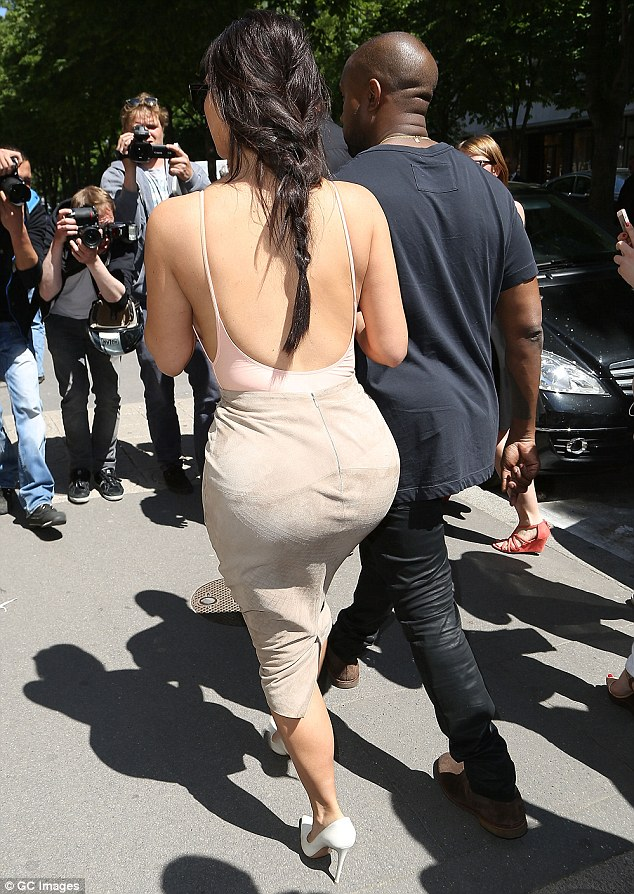 Bootylicious: Kim's famous derriere attracted almost as much attention from local photographers as the front of her outfit