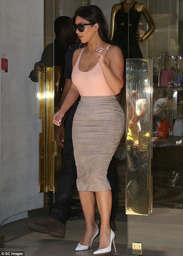 When one shop simply isn't enough: Ms Kardashian was later seen emerging from the Versace store on Avenue Montaigne