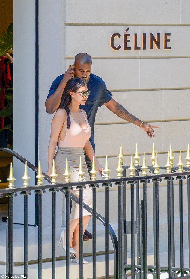 Ladies first: Kanye took a step back as he waited for his bride to be to leave first