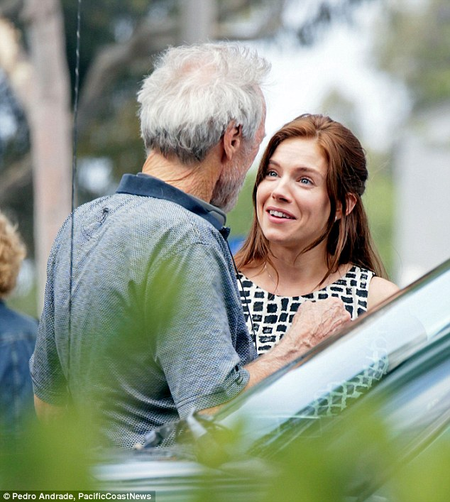 All smiles: The 32-year-old sported reddish brown locks and seemed to enjoy her chat with Eastwood
