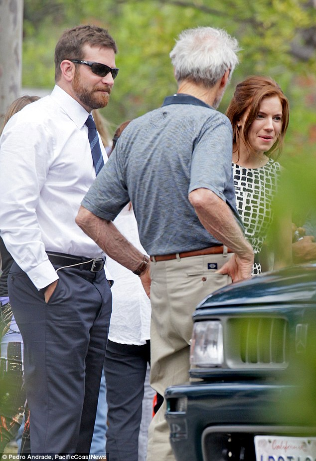The man in charge: Clint was also giving instructions to Bradley Cooper on the set