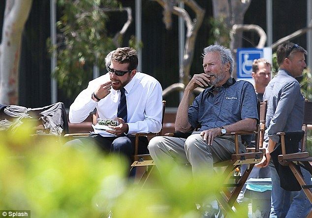 Director's chair: Clint didn't take time to eat himself and sat back while Bradley enjoyed his meal