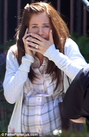 Distraught: The actress' character Taya Kyle was talking on the phone and then started weeping