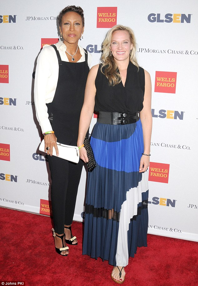 Complementary couple: The pair, who have been together since 2005, looked chic in their outfits, with the GMA co-anchor opting for black overalls, a white shirt and T-bar stilettos while her partner chose a patterned maxi-skirt, black V-neck sleeveless blouse, thick black buckled belt and sandals