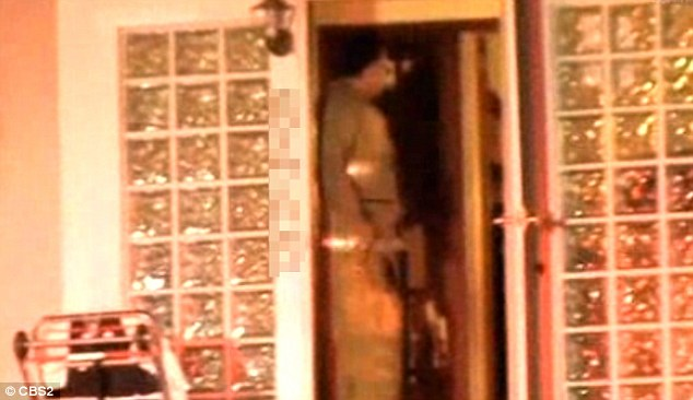 Police officers emerge from the LA mansion of actor Michael Jace after he called 911 on Monday night, allegedly saying he had shot his wife