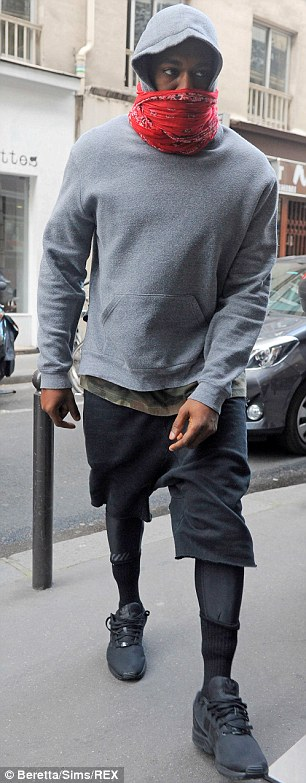 Only a few days to go! The rapper kept the hood of his grey sweatshirt up
