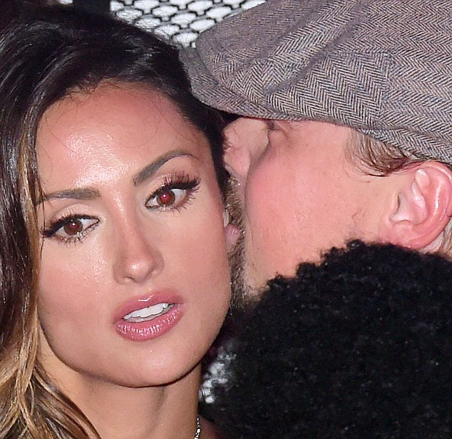 Pucker up: Leo whispered in the former America's Next Top Model star's ear