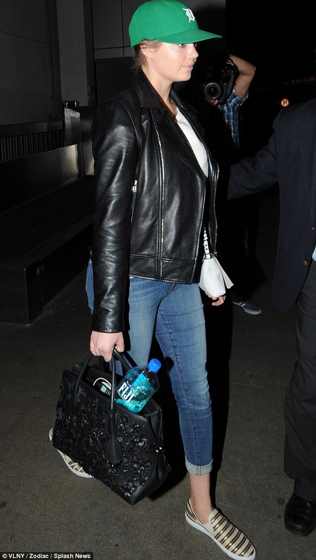 Low-key: The 21-year-old kept her famous curves under wraps, as she stepped out in cropped jeans and a leather jacket