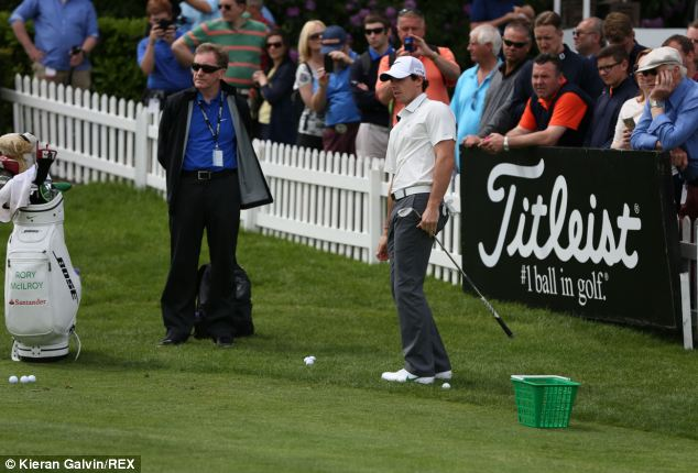McIlroy, pictured at the BMW PGA Pro-Am Championship today, said the split was 'mutual and amicable'