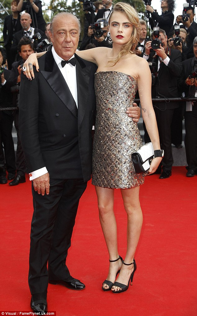 Hanging out: Cara draped herself around Fawaz Gruosi on the red carpet