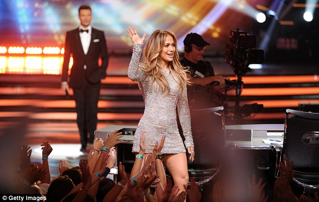 Outfit change: J-Lo arrived on stage in a long sleeved grey glittery dress before her outfit swaps