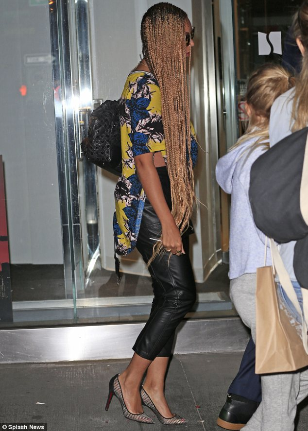 Just like Rapunzel: As well as showing off her new tresses, the singer turned heads in leather cropped trousers and a colourful top