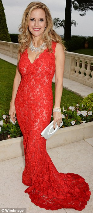Ravishing in red: Kelly Preston wore a lacy number with train while Bar Refaeli sizzled in a slinky gown with one sleeve and slit skirt